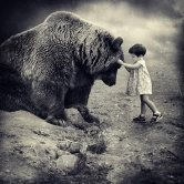 photo of a child with a large bear by Sarolta