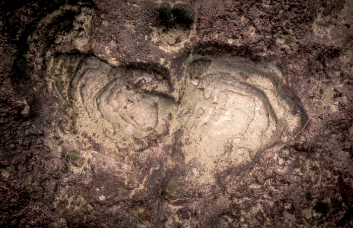 Layers of rock shot from above, resembling a heart shape