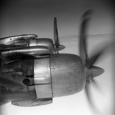 Black and white image of vintage airplane propellors in flight