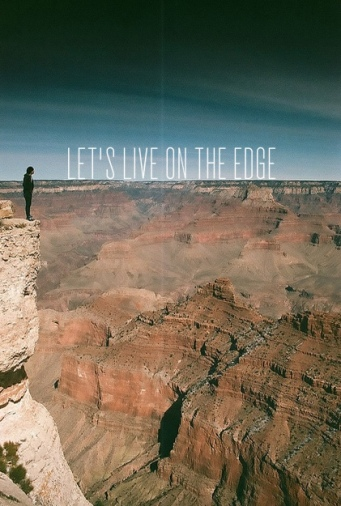 "View of a person standing on edge of cliff at Grand Canyon with the quote ""Let's live on the edge"""